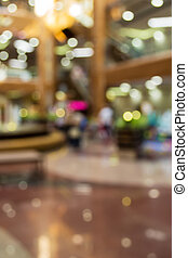 Blurred background: interior of shopping-mall gallery -...
