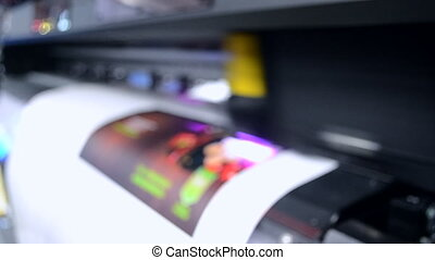 Large format printer works close-up. - Blurred Background....