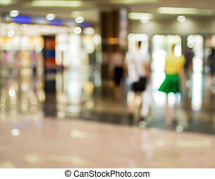 Blurred Background: man and woman are by and large store.