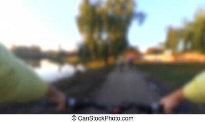 Blurred background. Man rides a bicycle with an action ...