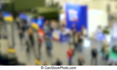 Blurred background. Many people exhibition top view. - ...