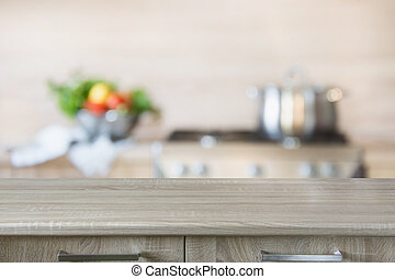 Blurred background. Modern kitchen with empty wooden tabletop, space for you and display your products.