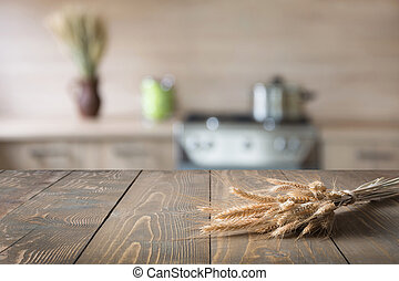 Blurred abstract background. Modern kitchen with tabletop with wreath.