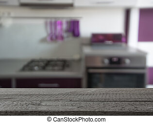 Blurred background. Modern kitchen with tabletop and space for you design.