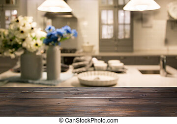 Blurred background. Modern kitchen with empty wooden tabletop and space for you design.