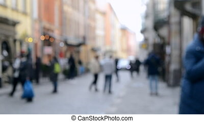 Blurred Background of many people on street square city town...