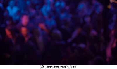 Blurred background of night club's audience in 4K
