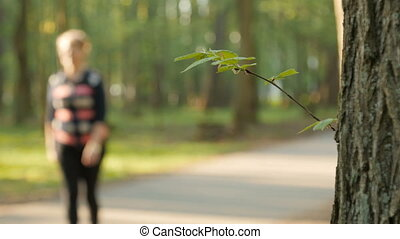 Blurred background of people activities in park with bokeh, spring and summer season