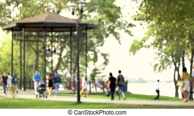 Blurred background of people in park.