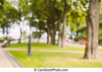 Blurred background of public park in the city