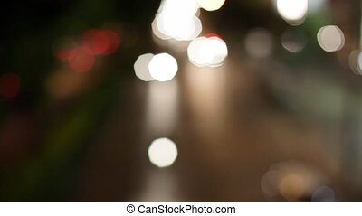 Blurred background of road traffic on night street in town....