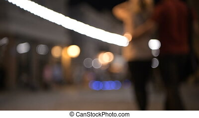 Blurred background of street lights at night city with two...