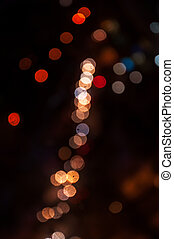 Blurred background of the city at night. Colorful bokeh.