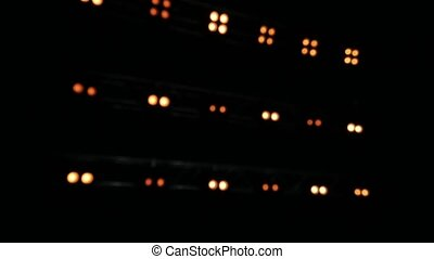 Blurred background of yellow lghts. Lights on the black ...
