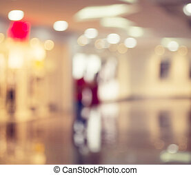 Blurred Background: people go for Shopping Mall along the...