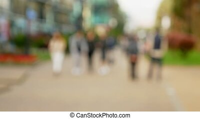 blurred background. people walk around the city. urban lifestyle background. passengers on a crowded street