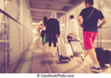 Blurred background : People walking in the airport
