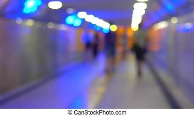 Blurred background, people walking through the underground...