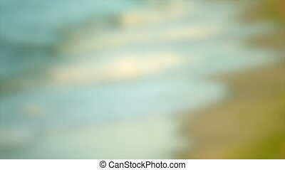 Blurred background. sea waves on the beach side, with sound