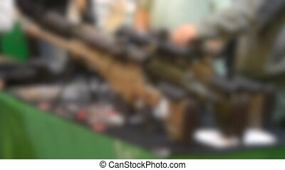 Blurred background. Several large-caliber weapons on the ...