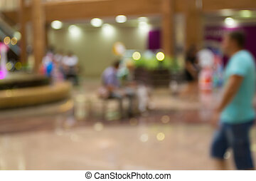 Blurred Background: shoppers in the mall, bokeh