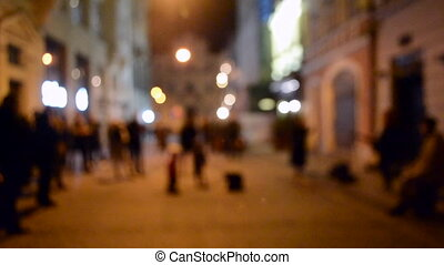 Blurred Background. Street musicians sing on the street of a European city