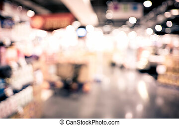 Blurred background supermarket store and product shelf with bokeh light