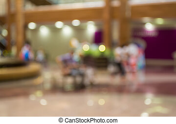 Blurred Background: The recreation area in the mall.