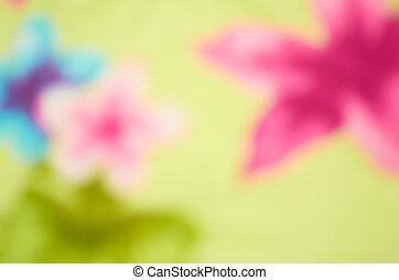 Unusual colorful bright flowers as fuzzy blurred background