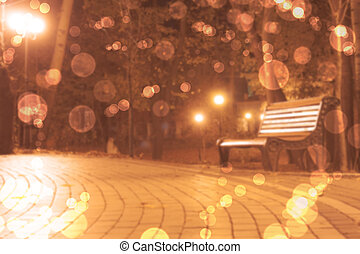 blurred background with bench in park and boke