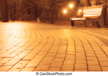 blurred background with bench in park