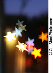 Blurred background with star-shaped highlights.