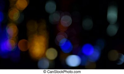 Blurred background with twinkling night street lights