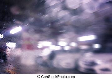 Blurred bokeh car park.