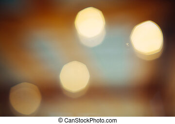 Blurred bokeh golden light abstract background.