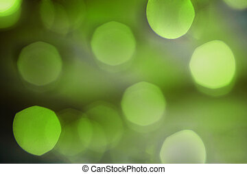 Blurred bokeh green light abstract background.