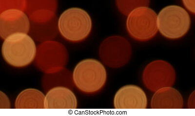 Blurred burning red round candles in catholic church -...