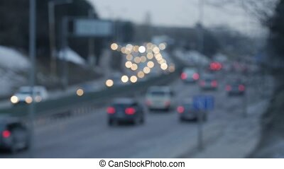 Out of focus traffic lights of cars on the sreet. - Blurred...