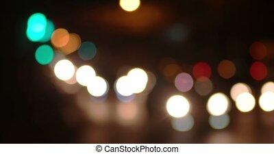 Blurred carlights irban traffic in a night time.