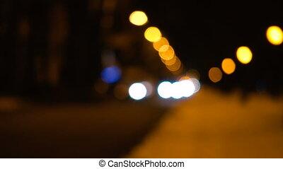 blurred cars lights  on a winter snowy  street