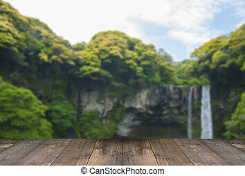 Blurred Cheonjiyeon Waterfall is a waterfall on Jeju Island, South Korea with wooden bridge.
