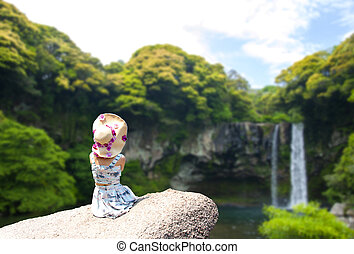 Blurred Cheonjiyeon Waterfall is a waterfall on Jeju Island, South Korea. The name Cheonjiyeon means sky. This picture could be use in promoting the place.