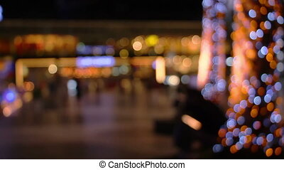 blurred christmas lights on trees in night city