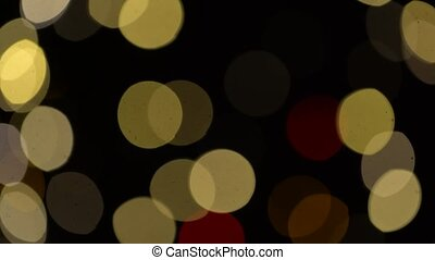 blurred christmas lights over dark background - illumination...