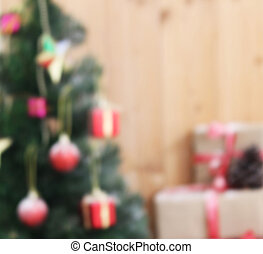 blurred christmas tree background with decorations gift on wooden board
