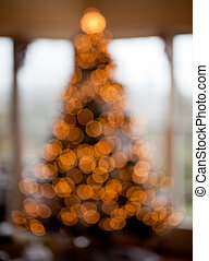 Blurred christmas tree in home