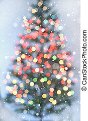 Blurred Christmas tree with colorful lights on white background
