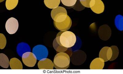 blurred chtistmas lights over dark background - illumination...