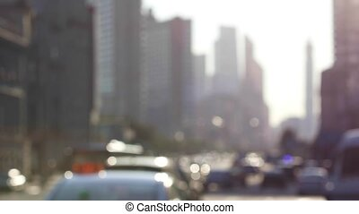 Blurred city traffic in the rays of the setting sun -...