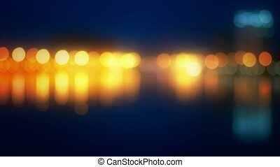 Blurred city view from riverbank. Intentionally blurred and...